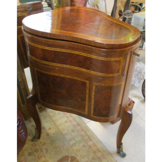 Antique French inlaid three-leg flip-up mirror top demilune vanity cabinet. When the small narrow drawer is pulled out,...