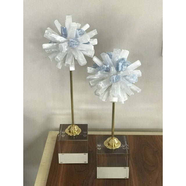 "Set of 2 natural Selenite sculptures on glass cube stand. Small: 5""x 5"" x 14"" high Large: 5"" x 5"" 16"" high By Blue Ocean..."