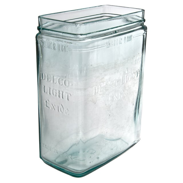 Rare, antique, Delco battery jar crafted from a light green glass. Once used to house a battery that powered farm...