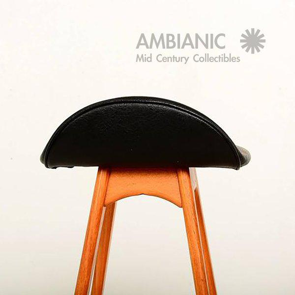 For your consideration a pair of Erik Buck bar stools made of teakwood with faux black leather. No label present from the...