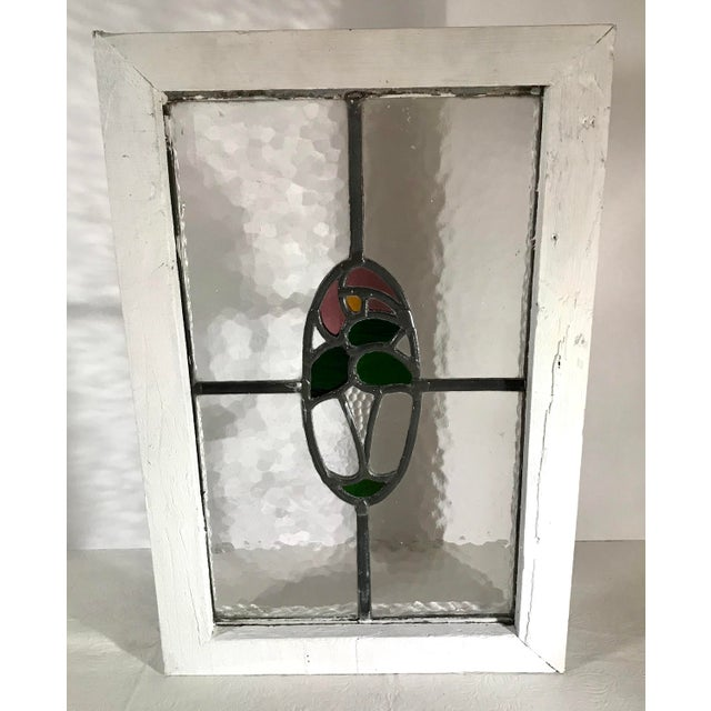 Beautiful multi colored vintage stain glass window from Europe and featuring a floral design. Hang or place in a window!...