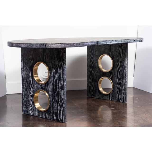 Glamorous desk in cerused oak with brass porthole details on the legs by On Madison. To order, 8-10 weeks. Custom ceruse...