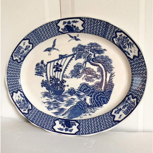 Wonderful vintage large blue and white ceramic platter with a Japanese junk ship scene. Marked Made in Japan.