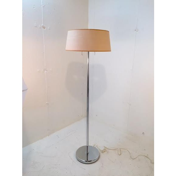 Early production Walter Von Nessen chrome floor lamp. Dual bulb/switch for reading or relaxing. Good vintage condition...
