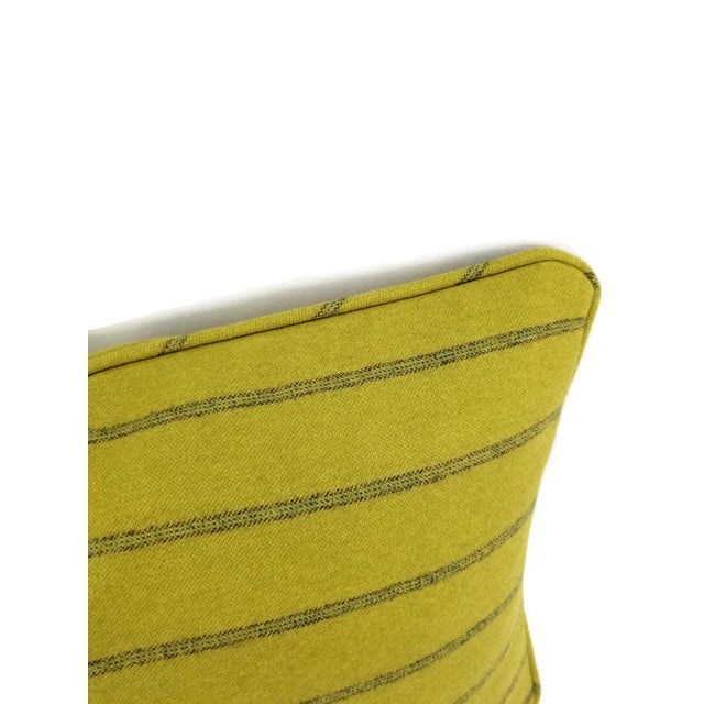 From Osborne and Little is Lomond Stripe in a light moss green color. The fabric is made with 100% wool fabric with a...