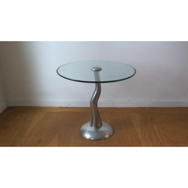 Love love love this solid aluminum base and glass side table. 20 inch beveled glass top helps keep it slick. So stylish...