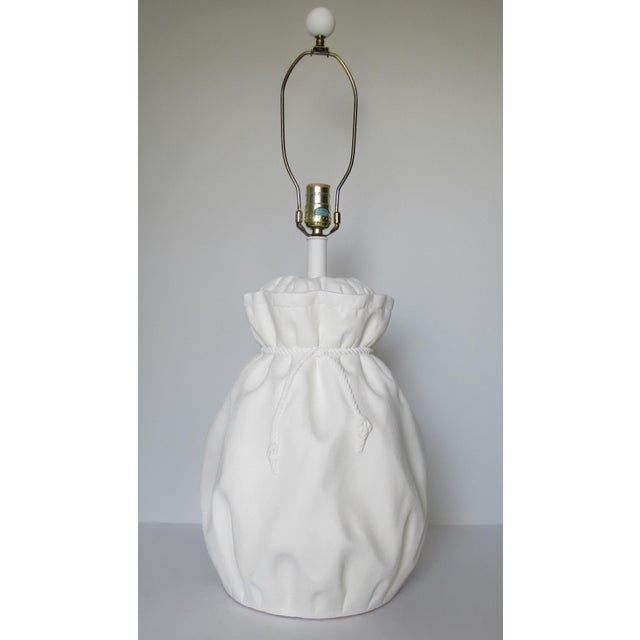 C.1970s; Vinatge, John-Dickinson style, draped plaster, bulbous rope, cinched lamp, in a tromp l'oeil effect, with dimpled...