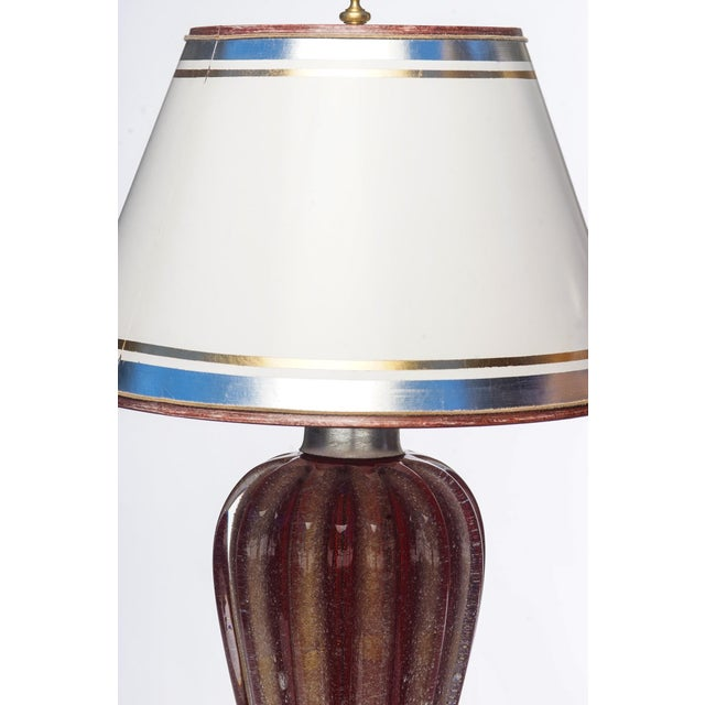 Pair of Mid-Century red and gold 1950's Murano lamps on lucite bases. The shades are included and are handcrafted in...