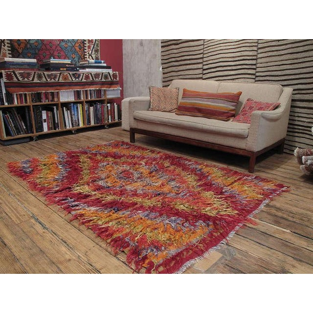 An old tribal rug from West Central Turkey, coarsely woven with long strands of colorful angora goat hair (mohair.) Such...