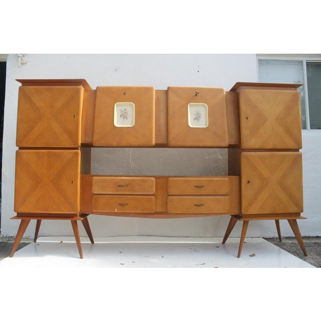 Vintage gorgeous 1950's Italian Piero Fornasetti style oak bar credenza. Features beautiful design, splayed legs, mirror...