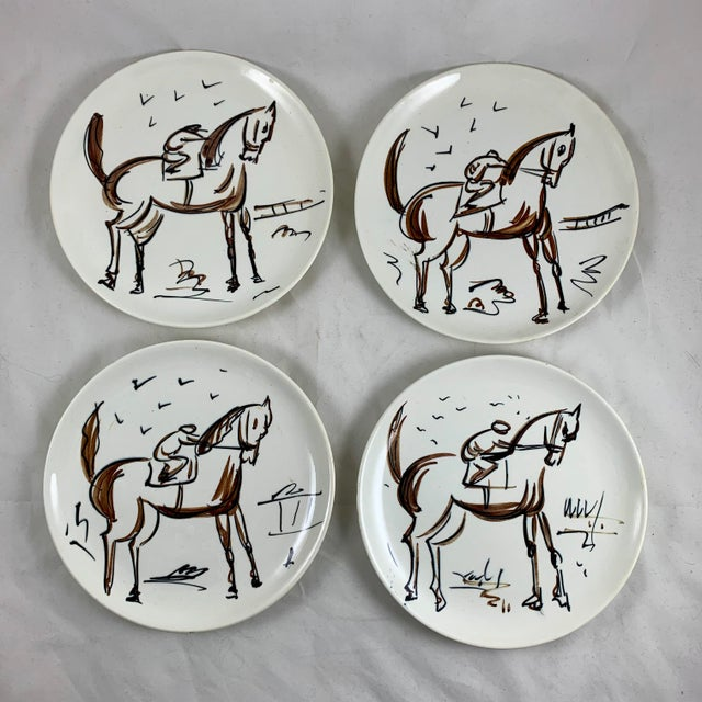 A scarce set of eight Mid-Century Modern pottery plates, designed and hand-painted by the American industrial designer Ed...