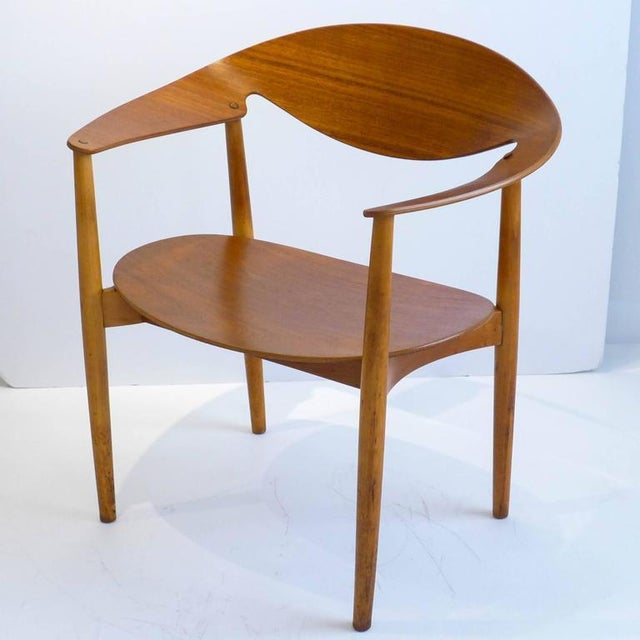 Early and rare metropolitan chair of teak plywood and lathe-turned beech. Designed by Aksel Bender Madsen and Ejner Larsen...