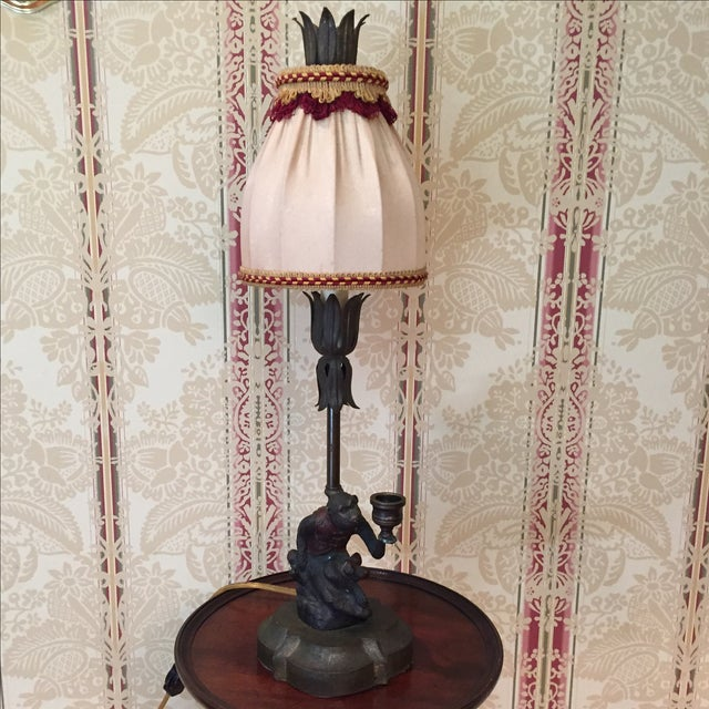 Whimsical Monkey Lamp by Chelsea House. Has a three-way light switch. Heavy bronze base. Silk embellished shade. He's...