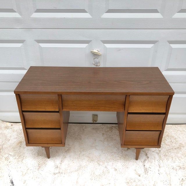 This stylish Johnson Carper writing desk features concave curved front drawers with a formica-style writing top for a...