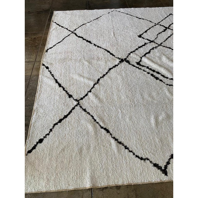 Dichromatic minimal rug with organic diamond and zig-zag shapes on antique white background. Vintage Hemp used in creating...