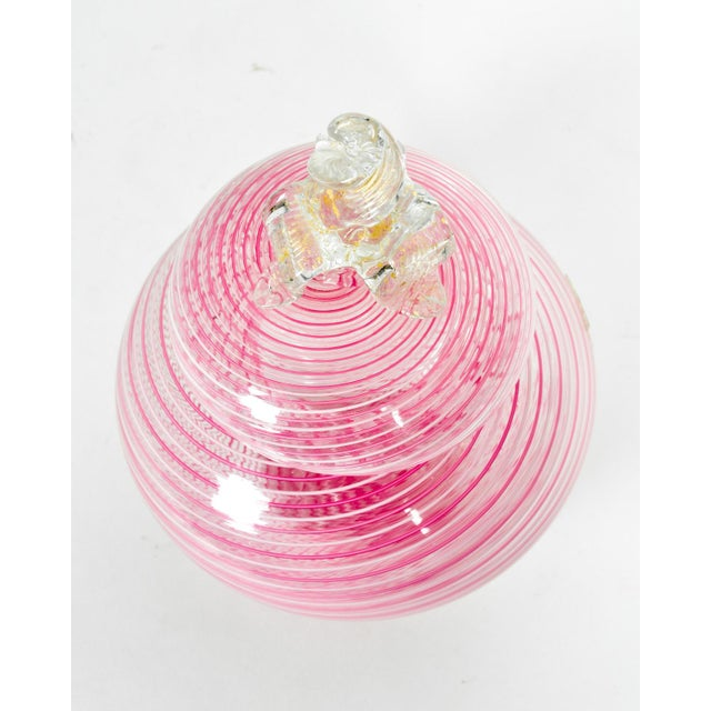 Vintage Murano glass vanity jar with pink swirls and decorative finial. All in excellent condition. The Jar measure 5.5...