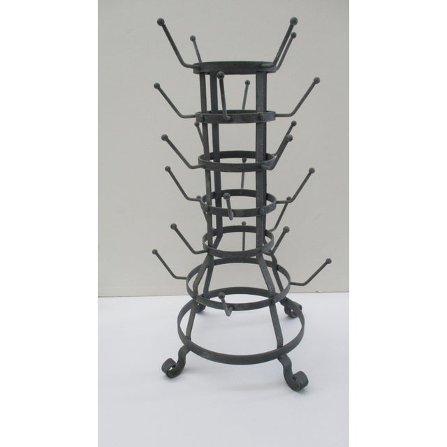 French style bottle or cup drying rack with distressed zinc finish. Holds 24 bottles or cups. A stylish and very handy way...