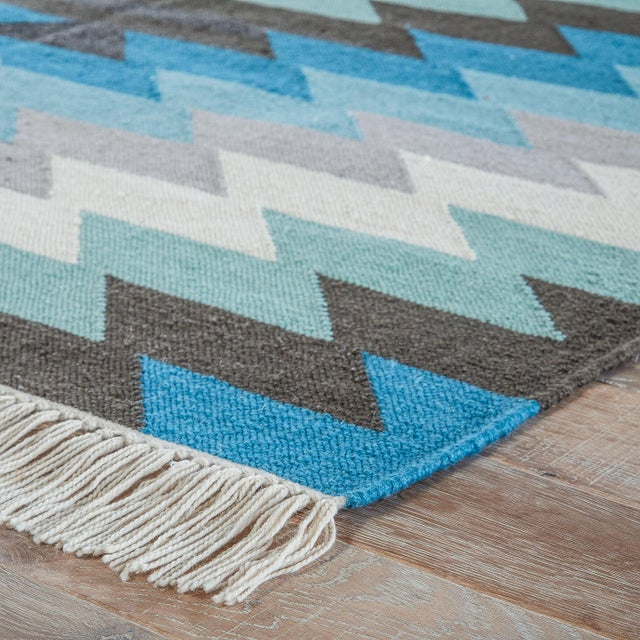 This chic indoor or outdoor flatweave rug showcases a contemporary twist on the classic kilim style. Cool-toned and...