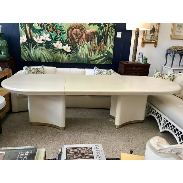 Gorgeous Karl Springer Oval Dining Table in Linen wrapped off white lacquer wit 2 leaves. This is a double pedestal oval...
