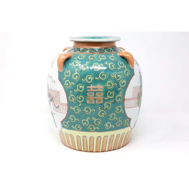 A vintage, hand-painted ceramic lidded and spouted jug, with scenes of people on a foo lion, double happiness symbols, and...