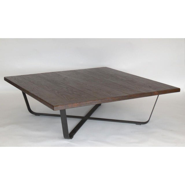 Custom Walnut top on hand forged graceful iron base. Can be made in custom sizes and finishes. Made in los Angeles by Dos...