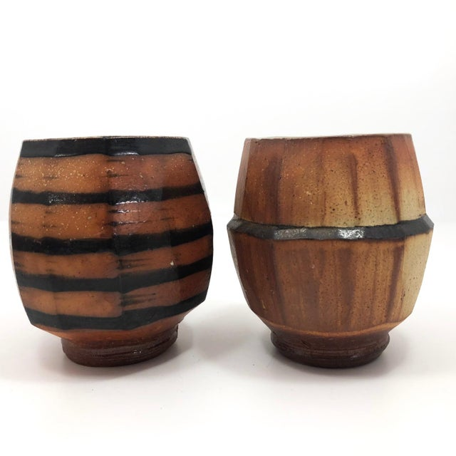 This is a striking pair of Japanese style faceted pottery cups with what I believe is a Yunomi form. Beautifully crafted,...