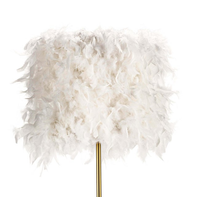 Go glam with Jasmine floor lamp. Real duck feathers top a delicate natural brass base to provide a look akin to a graceful...