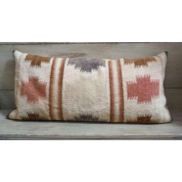 This wonderful muted colors Indian weaving bolster pillow has soft colors with a tan cotton linen backing. The insert is...