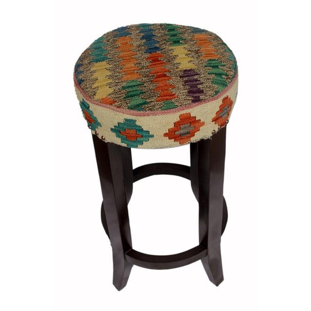 Stylish sophisticated and out of ordinary handmade bar stool crafted by skilled artisans using vegetable dyed hand-woven...