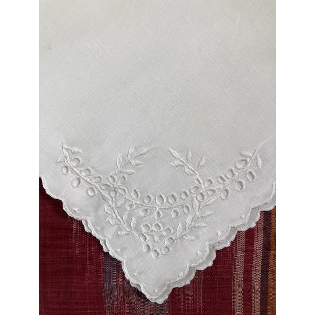 A set of 6 hand embroidered white on white linen napkins, starched pressed and ready to serve!