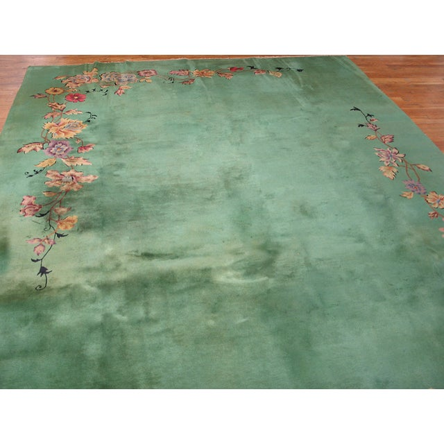 Antique Art Deco Rug with a green background and floral design