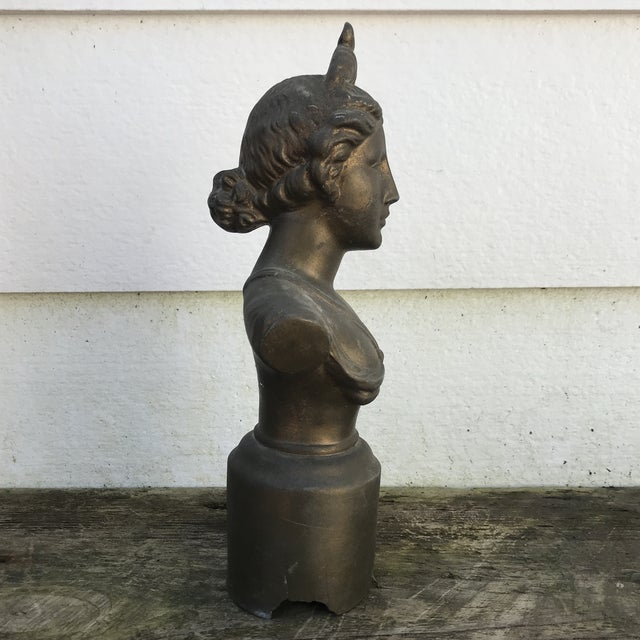 Beautiful dark metal bust of a woman. She has a classical appearance and a serene look. Some wear to the base and her...