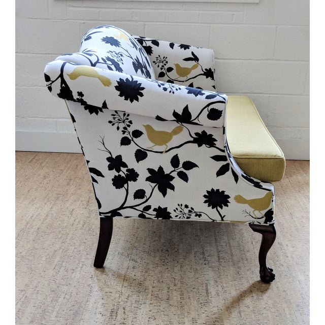 Add a touch of whimsy with this Chippendale camelback sofa with superb ball-and-claw feet. The vintage settee has been...