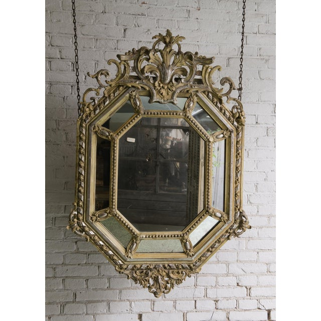 19th century octagonal mirror with mirror-borders ; silver leaf gilded , Provenance France This 19th Century French...