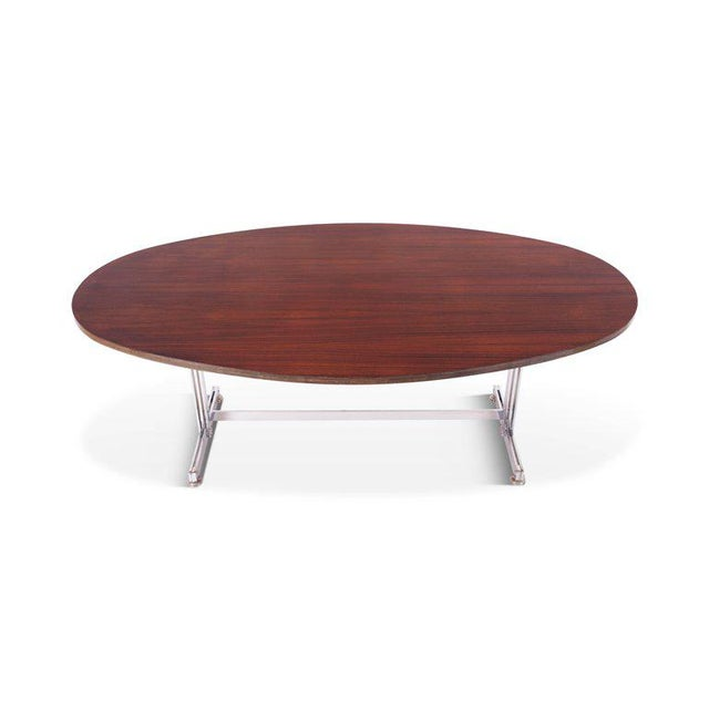 Jules Wabbes oval dining table for Mobilier Universel, circa 1960, Belgium. Multiplex top rosewood veneer. Heavy chrome-...
