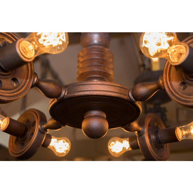 Interesting, one of a kind geometric Arts and Crafts style carved wood chandelier from Belgium, circa 1930. Newly wired...