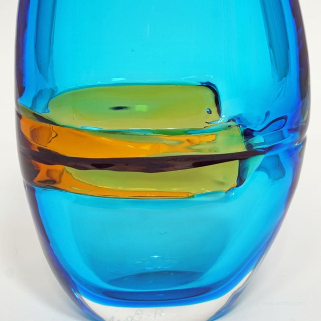 a large heavy glass vase manufactured and designed by alfredo barbini ca. 1965. thick clear, blue, yellow and black glass...