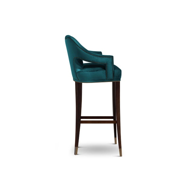 Symbol of knowledge and rebirth, Nº20 Counter Stool was raised through a long journey of 24 prototypes. This fabric chair,...