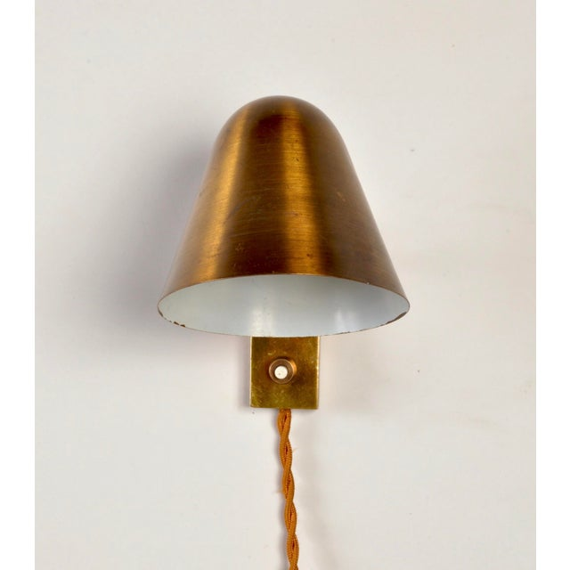 Nice well aged brass wall lamp from french lighting designer Jacques Biny.