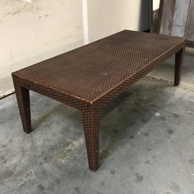 Mitchell Gold + Bob Williams wicker coffee table, which offers clean lines and a great size. Some light scuffs as seen in...