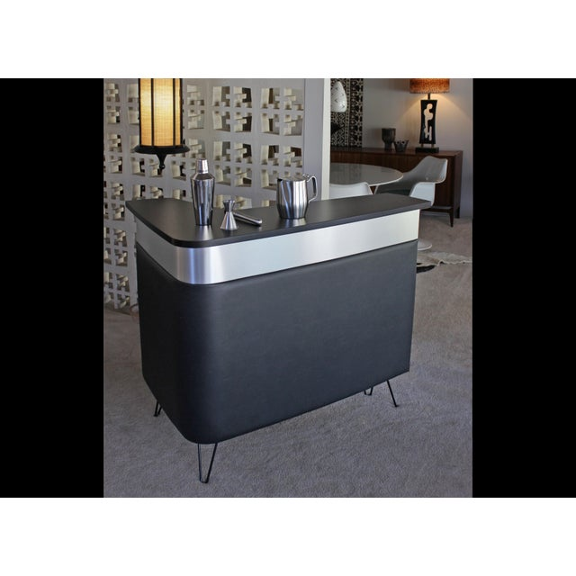 The Boomerang bar is inspired by the Mid-century Modern era. Designed and handcrafted in California, the bar features...