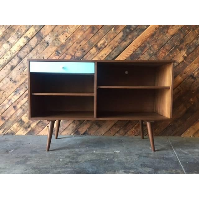 Mid Century Style, walnut wood, newly made Credenza with one custom blue drawer. available in your choice of size and...