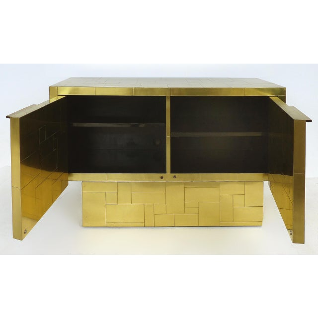 Offered for sale is a brass Paul Evans Cityscape two-door credenza cabinet for Directional Furniture. The two-door cabinet...
