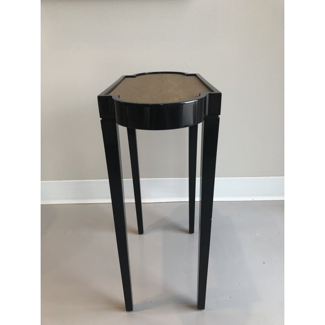 Oomph Tini Table II. A solid wood construction with high-gloss club black lacquer finish with a brown shagreen table...