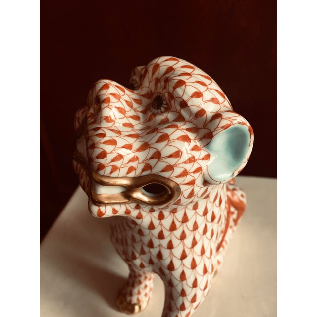 Fine porcelain by Herend from Hungary, made in 1986, decorative Foo Dog. He is painted with the rust colored fishnet...