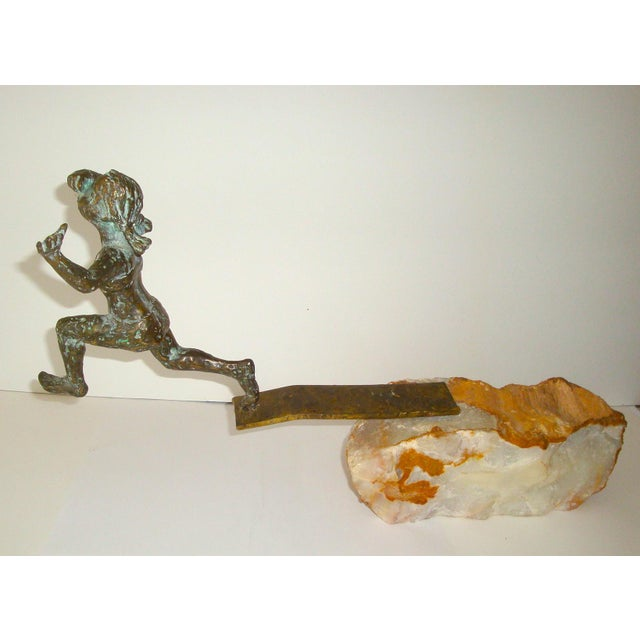 Unusual tabletop sculpture by Curtis Jere with bronze sculpture of a young girl leaping off a diving board that is...