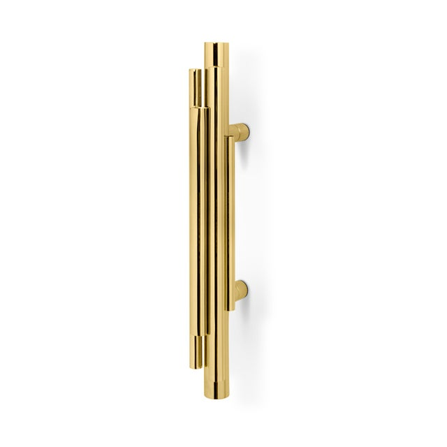 DESCRIPTION Asymmetrical polished brass tubes compose this artistical series of Furniture and Door Handles taking...