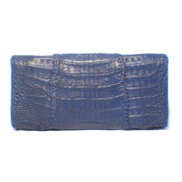 This simply stunning Carlos Falchi clutch is a must have for any collector's wardrobe. The exterior is in beautiful...
