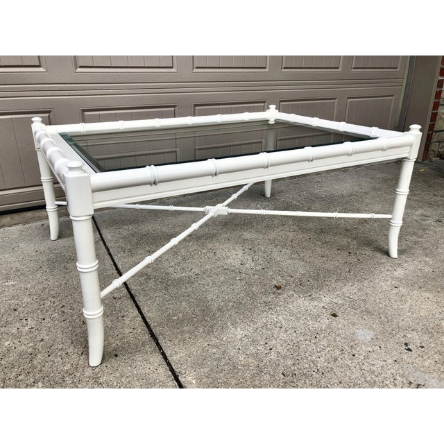 1960s Thomasville faux bamboo coffee table. We have refinished this piece with a glossy lacquer in the shade of White...