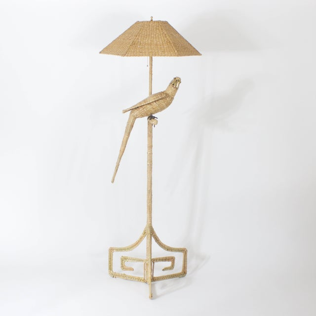 Whimsical wicker or reed Parrot floor lamp with a brass and copper beak and brass face. Featuring a matching wicker shade...